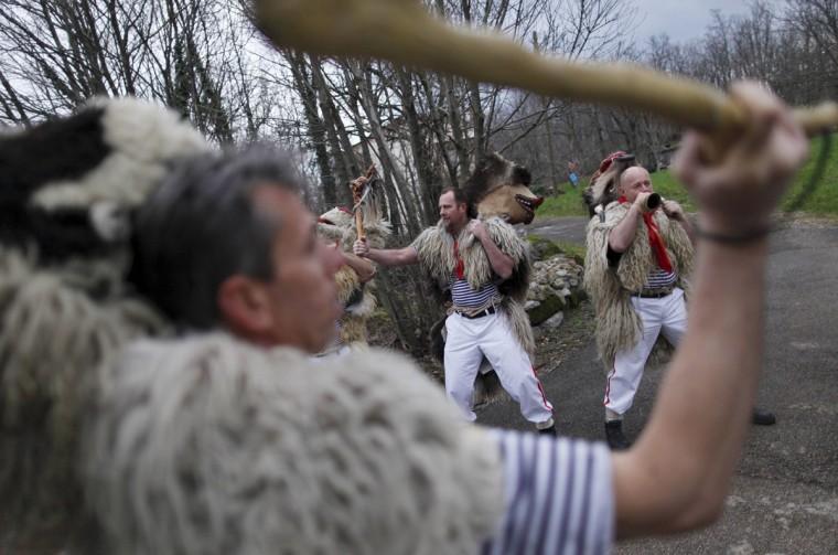"Bell ringers, or ""Zvoncari"", take part in a parade in a village near Rijeka, Croatia, March 2, 2014. (Antonio Bronic/Reuters)"