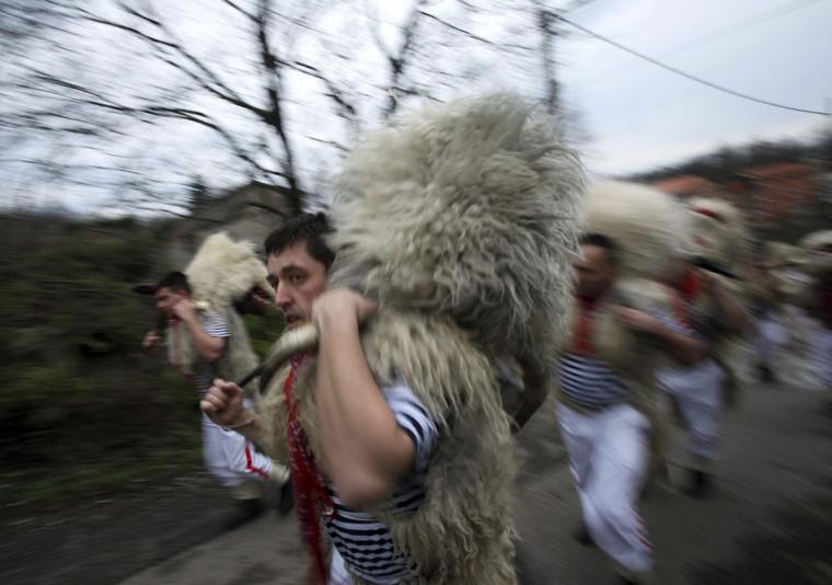 "Bell ringers, or ""Zvoncari"", walk in a parade in a village near Rijeka, Croatia, March 2, 2014. (Antonio Bronic/Reuters)"