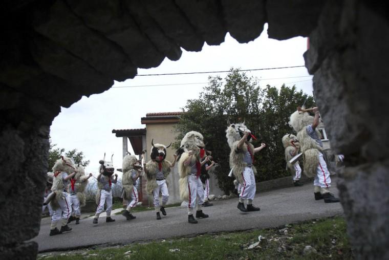 "Bell ringers, or ""Zvoncari"", walk in a parade in a village near Rijeka, Croatia March 2, 2014. (Antonio Bronic/Reuters)"