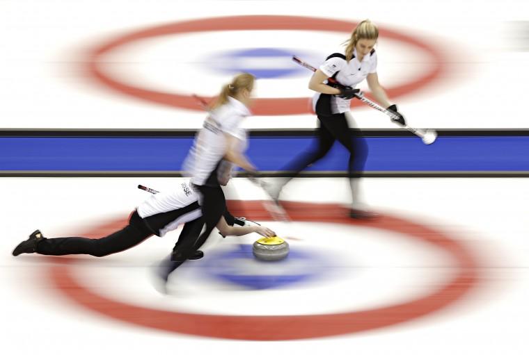 Switzerland's second Franziska Kaufmann delivers a stone during her semi-final game against South Korea at the World Women's Curling Championships in Saint John, New Brunswick. (Mathieu Belanger/Reuters)