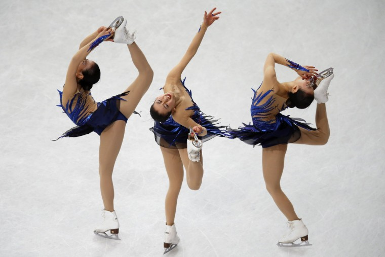 Japan's Mao Asada competes during the women's free program at the ISU World Figure Skating Championships in Saitama, north of Tokyo, March 29, 2014. Picture taken with multiple exposure. (Issei Kato / Reuters)