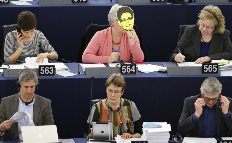 France's Nicole Kiil-Nielsen, a member of the Greens/European Free Alliance of the European Parliament, holds up a portrait of former National Security Agency (NSA) contractor Edward Snowden during a vote. The NSA's surveillance program and its impact on the fundamental rights of European Union. (Vincent KesslerReuters)