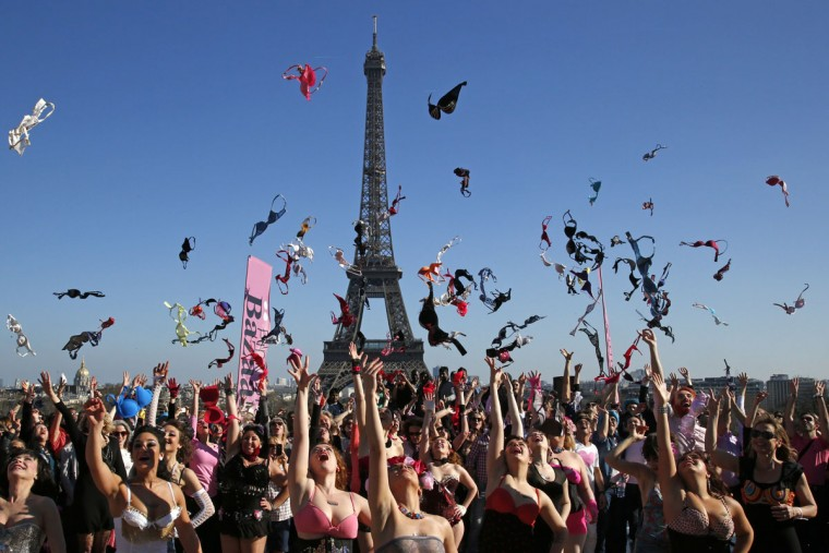 Women toss their bras during the 5th Pink Bra Spring and Bra Toss and help Push Up the Fight Against Breast Cancer event at the Trocadero Square near the Eiffel Tower in Paris March 16, 2014. Pink Bra Bazaar is a charity dedicated to breast health education and supporting women diagnosed with breast cancer. (Benoit Tessier/Reuters)