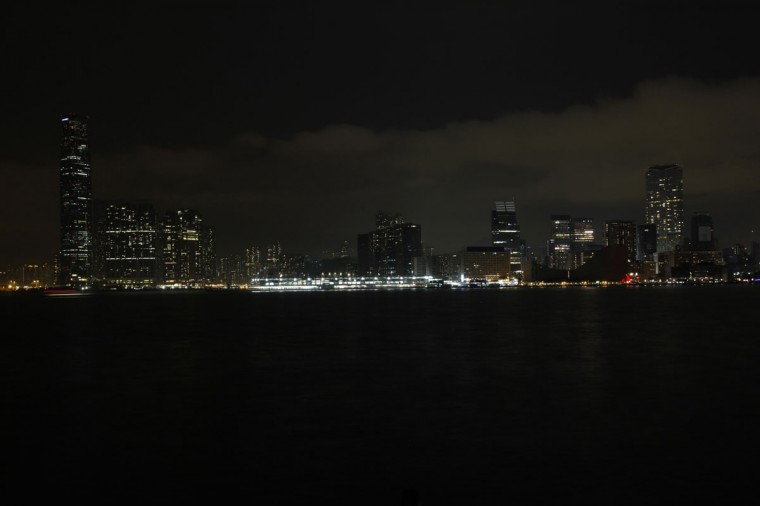 Kowloon peninsula, with Hong Kong's highest skyscraper International Commerce Centre, is seen across the harbor during Earth Hour on March 29, 2014. (REUTERS/Bobby Yip)