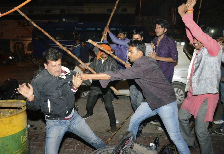 Supporters of Aam Aadmi (Common Man) Party (AAP) and India's main opposition Bharatiya Janata Party (BJP) clash during a protest outside the office of BJP in the northern Indian city of Lucknow. Street clashes marred an announcement on Wednesday that India's general election will start on April 7 as passions run high in a race that pits Hindu nationalist Narendra Modi against the unpopular Nehru-Gandhi family's ruling party. (Reuters)