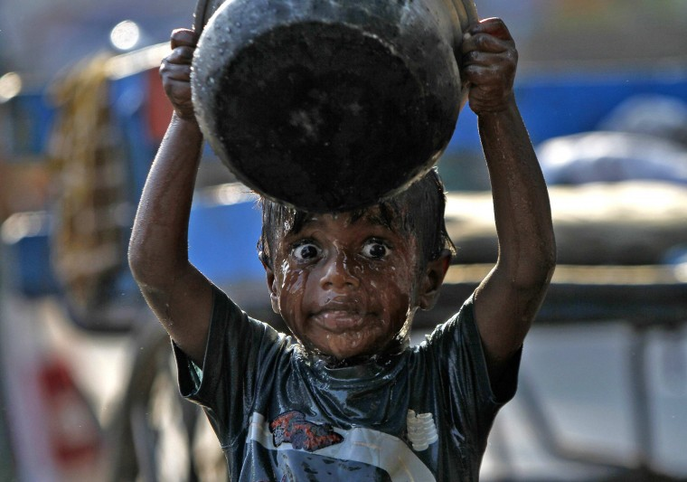 A boy takes a bath in the southern Indian city of Chennai as World Water Day is celebrated. (Babu/Reuters)