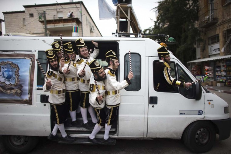 Ultra-Orthodox Jewish men wearing costumes celebrate the holiday of Purim in Jerusalem's Mea Shearim neighbourhood March 17.  || PHOTO CREDIT: RONEN ZVULUN  - REUTERS