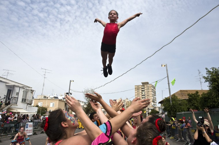 Dancers perform during the annual parade for the Jewish holiday of Purim in Holon, near Tel Aviv March 16, 2014. Purim is a celebration of the Jews' salvation from genocide in ancient Persia, as recounted in the Book of Esther. (Nir Elias/Reuters)