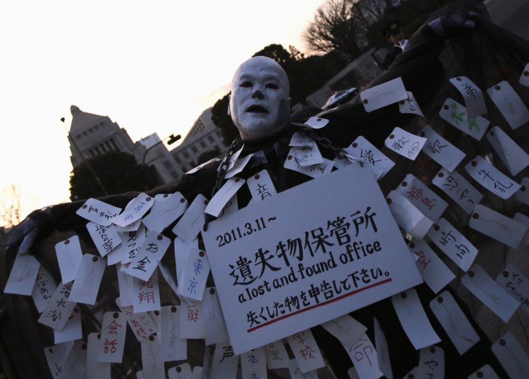 An anti-nuclear protester wearing zombie makeup and a costume walks in front of the Parliament in Tokyo, March 9, 2014. Thousands of anti-nuclear protesters marched in the Japanese capital on Sunday, ahead of the third anniversary of an earthquake and tsunami that triggered the world's worst atomic disaster in 25 years. (Yuya Shino/Reuters)