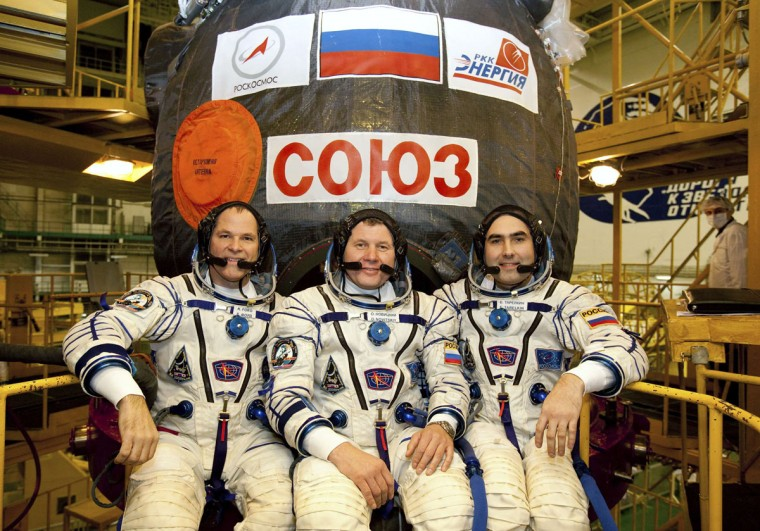 The International Space Station (ISS) crew members, U.S. astronaut Kevin Ford (left) and Russian cosmonauts Oleg Novitskiy (center) and Evgeny Tarelkin, pose in front of the Soyuz spacecraft as they undergo training at Baikonur cosmodrome on October 10, 2012. (REUTERS/Sergei Remezov)