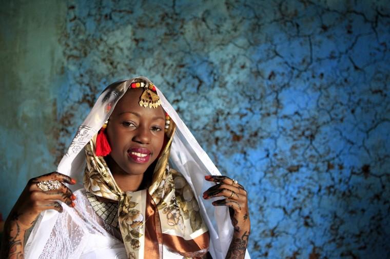 Kenyan bride Hawa Abdulkadir poses for a photograph during her traditional Nubian wedding ceremony in Nairobi's Kibera Slum. (Noor Khamis /Reuters)