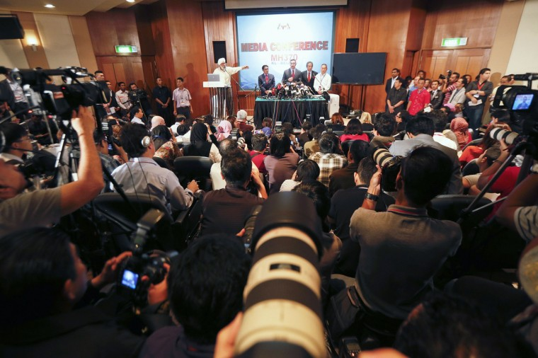 Malaysia's acting Transport Minister Hishammuddin Hussein (C) is accompanied by other senior officials as he addresses reporters about the missing Malaysia Airlines flight MH370, at Kuala Lumpur International Airport March 20, 2014. (Damir Sagolj/Reuters photo)
