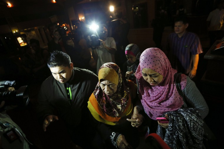 Family members of missing Malaysia Airlines flight MH370 passengers arrive for a briefing on the current situation at a hotel where other passenger's relatives are in Cyberjaya, outside Kuala Lumpur March 20, 2014. (Damir Sagolj/Reuters photo)