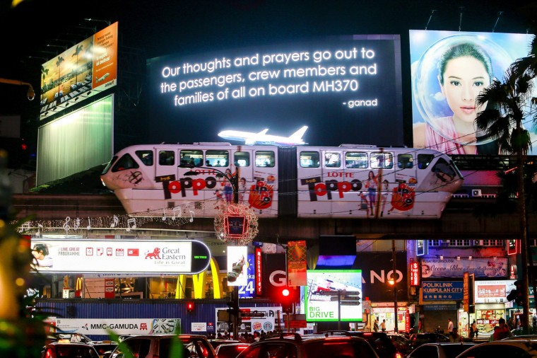 A message for passengers onboard the missing Malaysia Airlines Flight MH370 is seen on big screen in Kuala Lumpur March 20, 2014. (Samsul Said/Reuters photo)