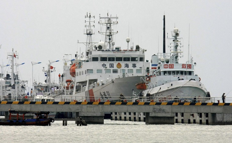 "China's largest patrol vessel in the South China Sea, ""Haixun 31,"" (center) is seen at a port before leaving for search and rescue operations for missing Malaysia Airlines flight MH370, in Sanya, Hainan province. Malaysian officials are poring over CCTV footage and questioning immigration officers and guards at Kuala Lumpur's international airport, concerned that a security breach may be connected to the disappearance of Malaysia Airlines flight MH370. (Stringer/Reuters)"