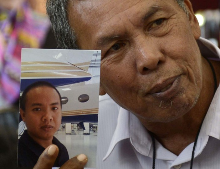 Selamat Omar shows a picture of his son, flight engineer Mohd Khairul Amri Selamat who was onboard the missing Malaysia Airlines Flight MH370, in Putrajaya. Malaysian police are investigating the aviation engineer who was among the passengers on the missing Malaysia Airlines plane as they focus on the pilots and anyone else on board who had technical flying knowledge, a senior police official said. Khairul, 29, is a Malaysian who has said on social media he had worked for a private jet charter company. Picture taken March 16, 2014.     || PHOTO CREDIT: REUTERS