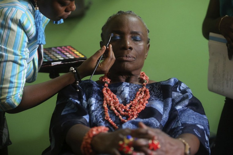 "Nigerian actress Taiwo Ajayi-Lycette gets makeup applied on her before filming a scene for ""Dazzling Mirage"", directed by Tunde Kelani, on the outskirts of Lagos, September 9, 2013. (Akintunde Akinleye/Reuters)"