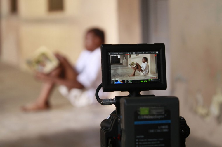 "A boy is seen through a camera monitor as he acts in a scene during the making of ""Ake"", a film based on the childhood memoirs of Nigerian writer Wole Soyinka, in Abeokuta, southwest Nigeria July 16, 2013. Nigeria's movie business, often known as Nollywood, is one of the biggest in the world. (Akintunde Akinleye/Reuters)"