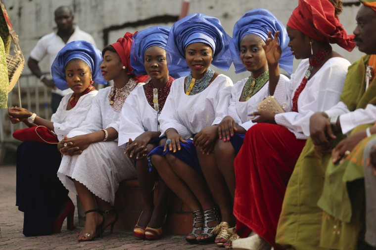 "Cast members dressed in traditional attire perform in a scene during the making of ""Dazzling Mirage"", directed by Tunde Kelani, at a film location in Lagos, December 19, 2013. (Akintunde Akinleye/Reuters)"