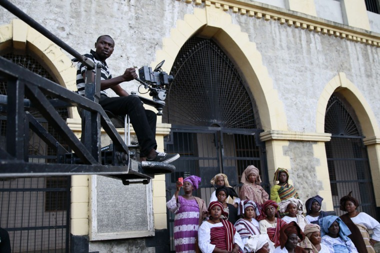"A cameraman films a scene from a crane during the making of ""Ake"" , a film based on the childhood memoirs of Nigerian writer Wole Soyinka, in Abeokuta, southwest Nigeria, July 14, 2013. (Akintunde Akinleye/Reuters)"
