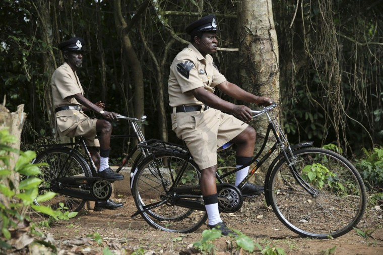 "Actors Sadiq Daba (L) and Aderupoko ride bicycles as they perform during filming for ""October 1"", a police thriller directed by Kunle Afolayan, at a rural location in Ilaramokin village, southwest Nigeria, August 24, 2013. (Akintunde Akinleye/Reuters)"