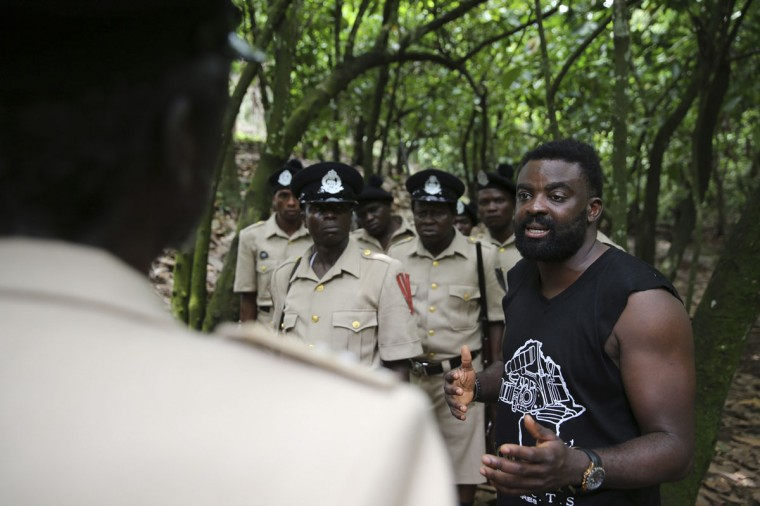 "Director Kunle Afolayan (right) directs a scene while filming police thriller ""October 1"" at a rural location in Ilaramokin village, southwest Nigeria, August 24, 2013. (Akintunde Akinleye/Reuters)"