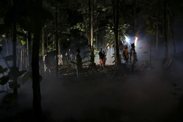 "Actors perform a scene at night while filming ""October 1"", a police thriller directed by Kunle Afolayan, at a rural location in Akure, southwest Nigeria, August 26, 2013. (Akintunde Akinleye/Reuters)"