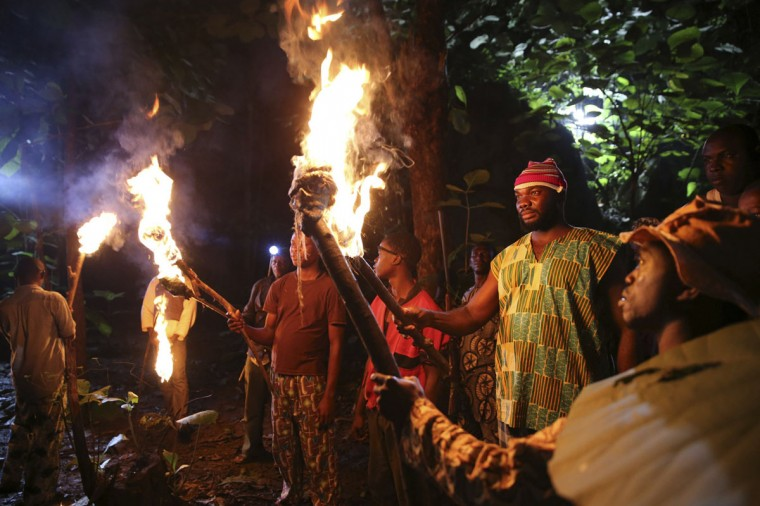 "Actors hold flaming torches as they perform while filming ""October 1"", a police thriller directed by Kunle Afolayan, at a rural location in Akure, southwest Nigeria, August 27, 2013. (Akintunde Akinleye/Reuters)"