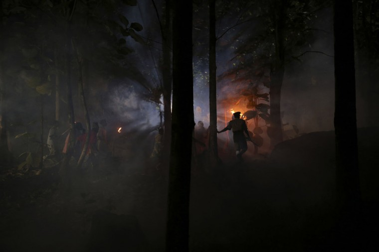 "Cast members perform a scene at night while filming ""October 1"", a police thriller directed by Kunle Afolayan, at a rural location in Akure, southwest Nigeria, August 26, 2013. (Akintunde Akinleye/Reuters)"