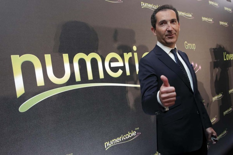 "Patrick Drahi, Franco-Israeli businessman, Executice Chairman of cable and mobile telecoms company Altice and founder of Numericable, poses prior to a news conference in Paris, March 17. Numericable backer Patrick Drahi promised to create a national champion, and a leader in fixed and mobile bundled offers by marrying his French cable company with Vivendi's SFR telecom unit. Speaking for the first time since winning a takeover battle for SFR against Bouygues Telecom, Drahi cast the deal as a sign of ""convergence"" between fixed and mobile, on the day that Vodafone also unveiled its 7.2 billion euro ($10 billion) purchase of Spanish cable operator Ono.     