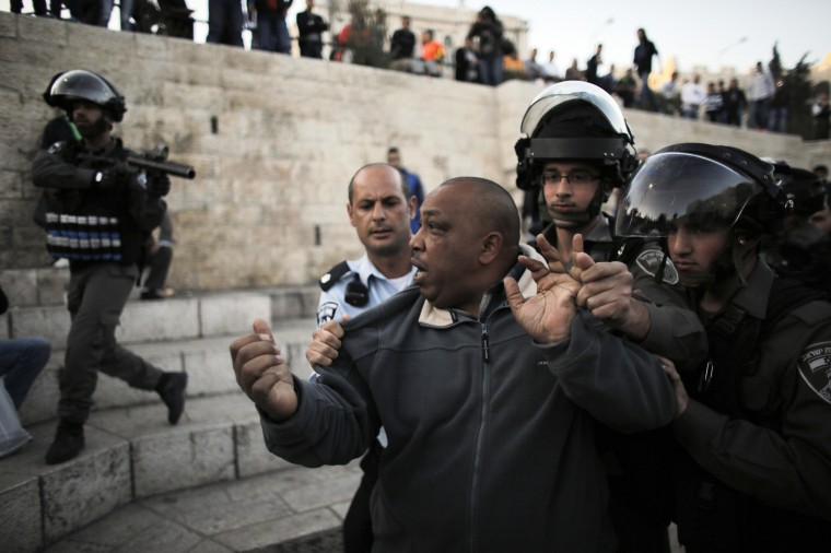 A Palestinian man is detained by Israeli border policemen during clashes near the Damascus Gate at Jerusalem's old city. Palestinians protested after Israeli forces shot three Palestinian militants dead during a raid and arrest attempt on a home in the West Bank refugee camp of Jenin earlier in the day. (Ammar Awad/Reuters)