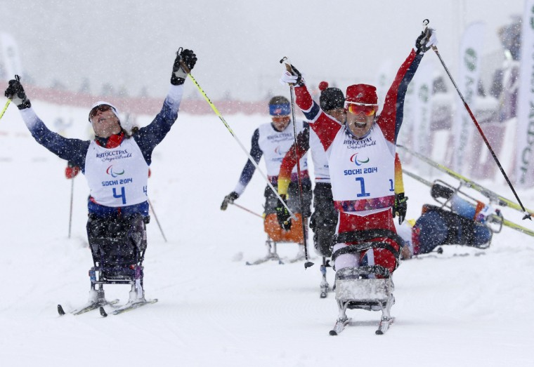 Norway's Mariann Martinssen (right) celebrates with second-place finisher Tatyana Mcfadden of the United States during the women's 1-km sprint cross-country sitting at the 2014 Sochi Paralympic Winter Games in Rosa Khutor. (Alexander Demianchuk/Reuters)