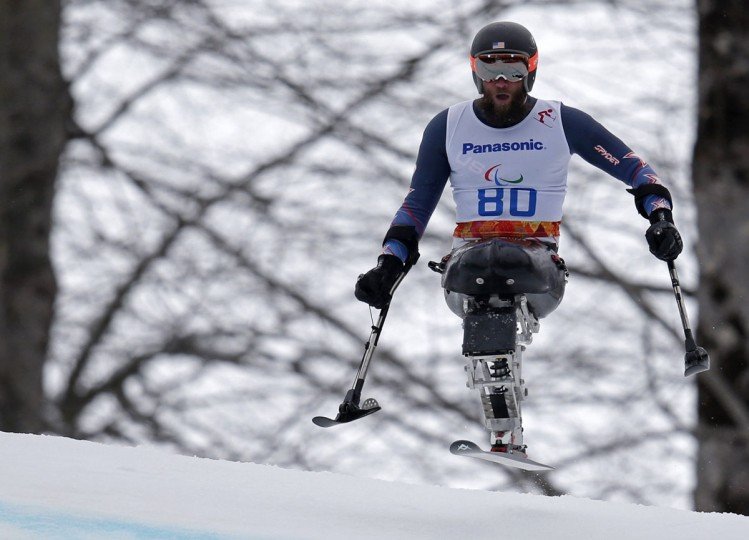 Heath Calhoun of the U.S. skis during the men's alpine skiing Super-G sitting event of the Super combined at the 2014 Sochi Paralympic Winter Games at the Rosa Khutor Alpine Center, March 14, 2014. (Christian Hartmann/REUTERS)