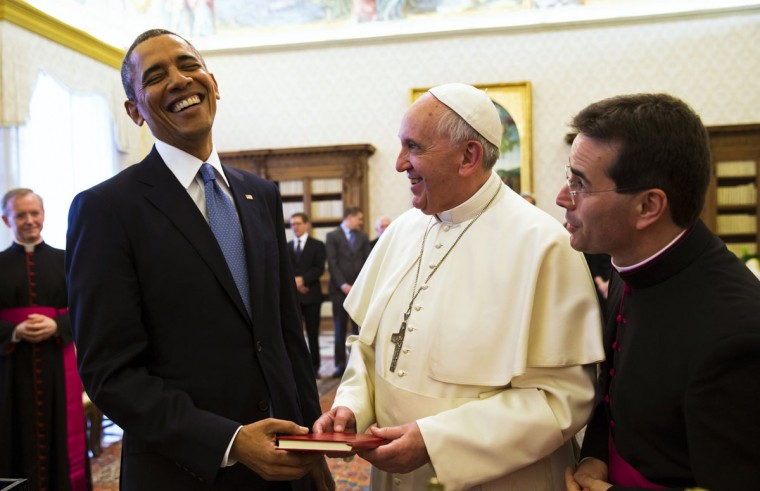 "U.S. President Barack Obama laughs while exchanging gifts with Pope Francis at the Vatican March 27, 2014. Despite differences on moral issues, Obama will find in Pope Francis a welcome ally on issues of poverty and social justice during their meeting. Obama has sparred with the Catholic Church hierarchy in the United States over his support for abortion rights, gay marriage and the ""contraception mandate"" that requires employers to provide health insurance cover for artificial birth control. (Kevin Lamarque/Reuters)"