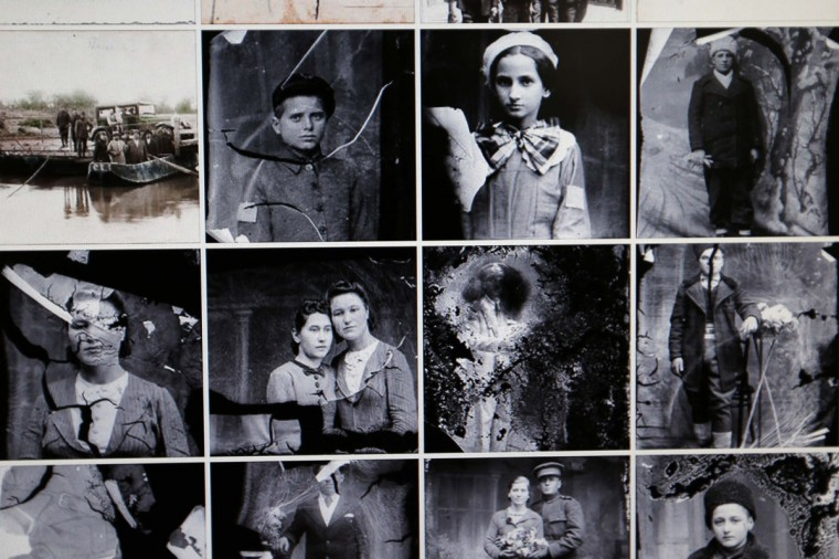 """Images scanned from """"Costica Acsinte"""" picture archive are pictured on a monitor in Slobozia February 18, 2014. (REUTERS/Bogdan Cristel)"""