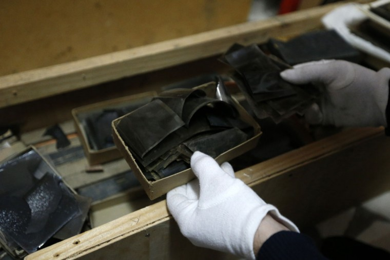 """Negatives from the """"Costica Acsinte picture archive"""" are seen at Ialomita county museum in Slobozia February 18, 2014. (REUTERS/Bogdan Cristel)"""