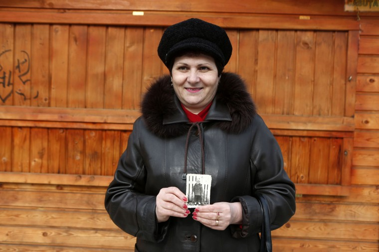 Marioara Paslaru holds a picture of her taken by Costica Acsinte about 50 years ago in Slobozia, February 21, 2014. (REUTERS/Bogdan Cristel)