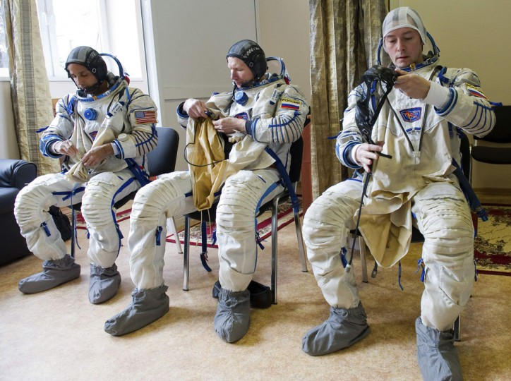 Russian cosmonauts Sergei Revin (right) and Gennady Padalka (center) and U.S. astronaut Joseph Acaba take part in a training session at the Star City space center outside Moscow on April 19, 2012. (REUTERS/Sergei Remezov)