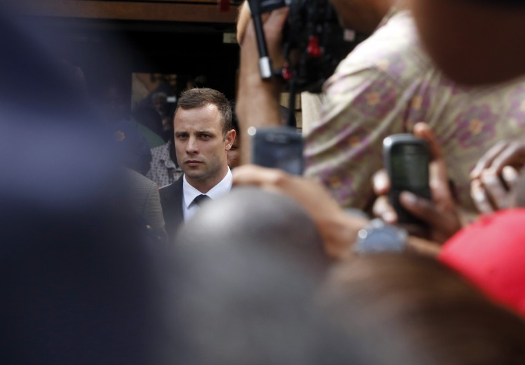Olympic and Paralympic track star Oscar Pistorius leaves court after the fifth day of his trial for the murder of his girlfriend Reeva Steenkamp at the North Gauteng High Court in Pretoria, March 7. CREDIT: MIKE HUTCHINGS - REUTERS
