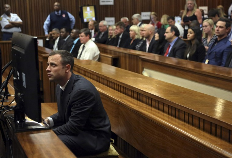 "Oscar Pistorius sits in court ahead of his trial at the North Gauteng High Court in Pretoria March 3, 2014. ""Blade Runner"" Pistorius arrived at the Pretoria High Court on Monday for the start of his murder trial, opening a decisive chapter in the story of the rise and fall of one of the world's best-known athletes. (Themba Hadebe/Pool/Reuters)"