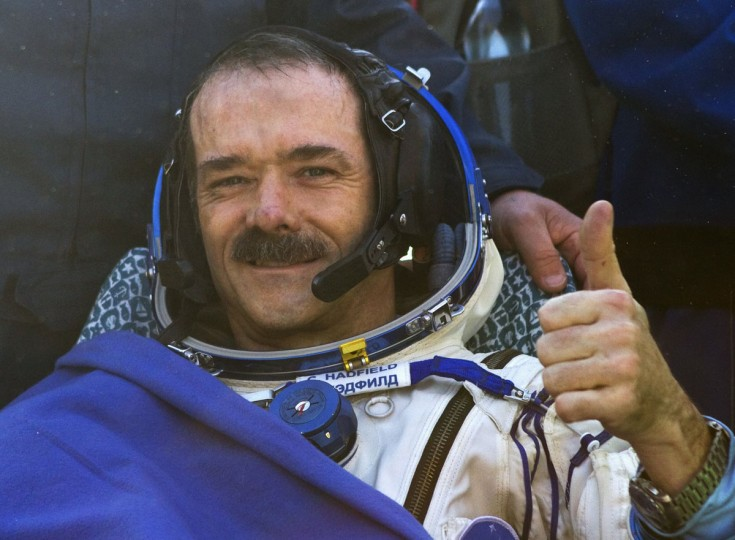 Canadian astronaut Chris Hadfield gestures after the Russian Soyuz space capsule landed some 90 miles southeast of the town of Zhezkazgan in central Kazakhstan on May 14, 2013. Hadfield, the first Canadian astronaut to command the International Space Station (ISS), landed safely in Kazakhstan with two crewmates, wrapping up a five-month mission aboard the ISS. (REUTERS/Sergei Remezov)