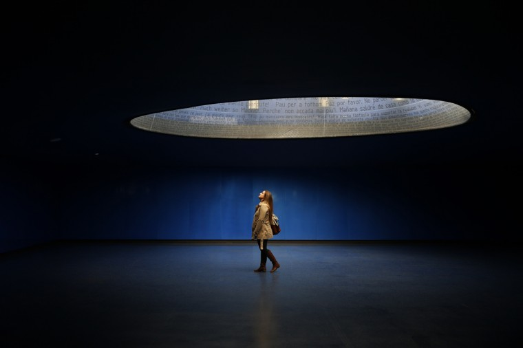 A woman visits the interior of the Madrid train bombing memorial at Atocha station, in Madrid March 11, 2014. The Spanish capital on Tuesday marked the tenth anniversary of the Madrid train bombings that killed 191 people and injured more than 1,500. (Susana Vera/Reuters)