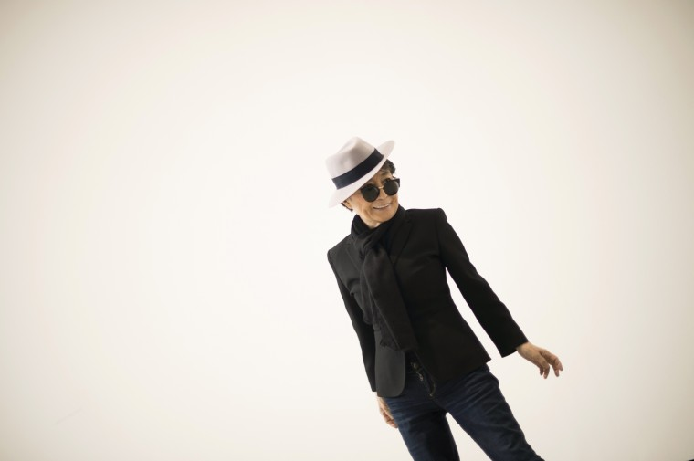 Artist Yoko Ono smiles during the presentation of Half A Wind Show: A Retrospective, at the Guggenheim Museum in Bilbao March 13, 2014. The exhibition features two hundred objects, drawings, installations, films and performance documentation from the Japanese conceptual artist's sixty year career. (REUTERS/Vincent West)