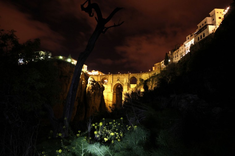 "The ""Puente Nuevo"" (New Bridge) is seen illuminated by artistic lights after Earth Hour in Ronda, near Malaga, Spain on March 29, 2014. (REUTERS/Jon Nazca)"