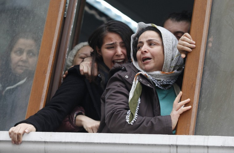 Berkin Elvan's sister Ozge (C) reacts as his coffin approaches the Okmeydani cemevi, an Alevi place of worship, in Istanbul March 11, 2014. Police and protesters clashed in Turkey's two biggest cities on Tuesday following the death of the 15-year-old boy who suffered a head injury during anti-government demonstrations last summer. Elvan, then aged 14, got caught up in street battles in Istanbul between police and protesters on June 16 after going out to buy bread for his family. He was struck in the head by a tear-gas canister and went into a coma. Alevis are a religious minority in mainly Sunni Muslim Turkey who espouse a liberal version of Islam and have often been at odds with Prime Minister Tayyip Erdogan's Islamist-rooted government. (Osman Orsal/Reuters)