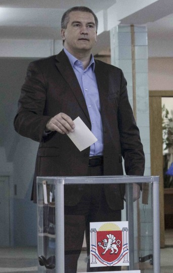 Crimean Prime Minister Sergei Aksyonov casts his ballot during voting in a referendum at a polling station in Simferopol, Ukraine, March 16, 2014. (Stringer/Reuters)