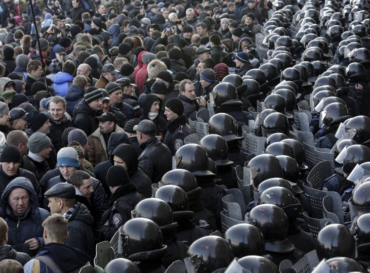 Riot police stand guard in front of the regional government building during a pro-Russian rally in Donetsk, Ukraine, March 9, 2014. Russian forces tightened their grip on Crimea on Sunday. (Konstantin Chernichkin/Reuters)