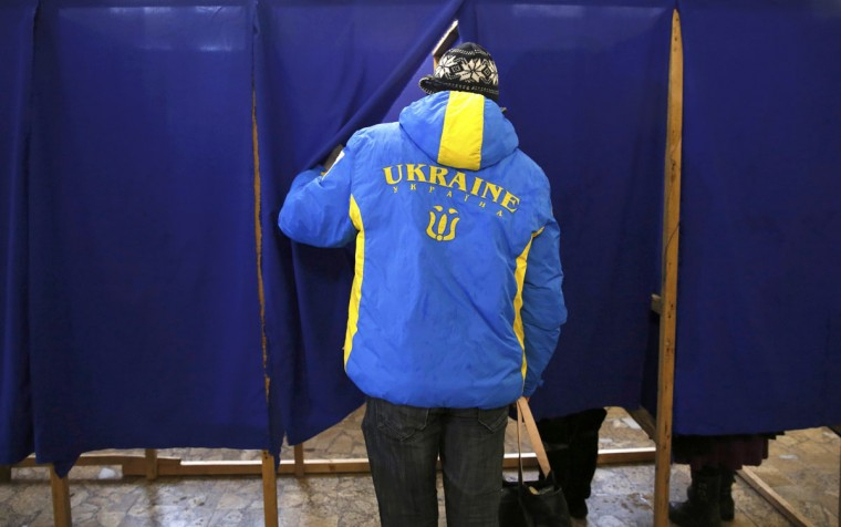 A man enters a voting booth during the referendum on the statusof Ukraine's Crimea region at a polling station in Sevastopol, Ukraine, March 16, 2014. (Baz Ratner/Reuters)