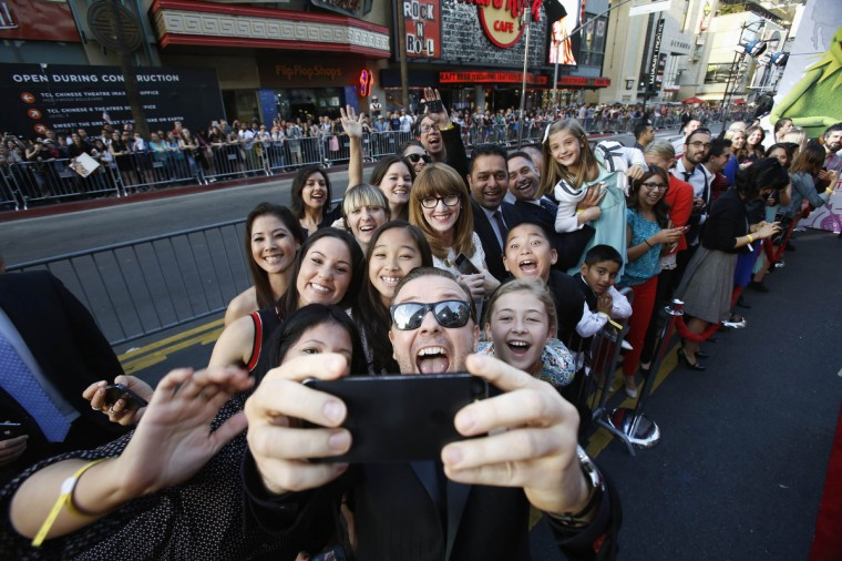"""Actor Ricky Gervais takes a """"selfie"""" with fans at the premiere of """"Muppets Most Wanted"""" at the El Capitan theatre in Hollywood. (Mario Anzuoni/Reuters)"""
