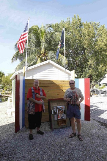 Huie Gordon (L) a retired Monroe County Sheriff's Deputy and neighbor of Doug Varrieur pose in front of their target and backstop with unloaded weapons in the yard of Varrieur's home in Big Pine Keys in the Florida Keys March 5, 2014. Varrieur, 57, discovered a little-noticed part of Florida law which prohibits local governments from restricting gun rights in any way, and in December he set up a personal gun range on his property in a residential subdivision. Neighbors were outraged by the live gunfire, but their surprise was nothing compared to that of municipal leaders, who were shocked to realize there was nothing they could do about it. Picture taken March 5, 2014. (REUTERS/Andrew Innerarity)
